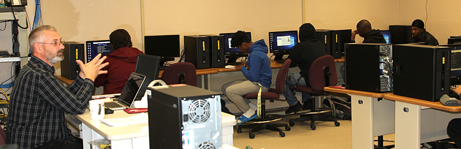 Instructor and students in computer lab