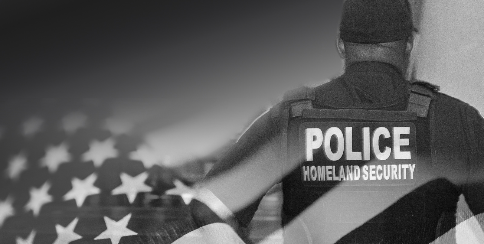 homeland police standing with black and white american flag