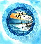 This circular design has as a ring of blue ice surrounding a winter landscape that meets a frozen lake that stretches to the horizon. The low sun streaks the sky with thin blades of orange and gold. A black, battered weather vane rises from the rocky shore, it is pointing to the north with the promise of cold winds on the way.